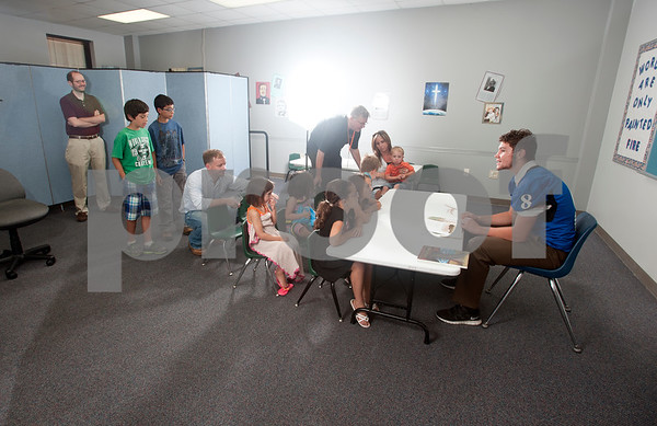 photo by Sarah A. Miller/Tyler Morning Telegraph  Behind the scenes of the East Texas Football Preview photoshoot with Grace Community School's running back Kade Clayton.