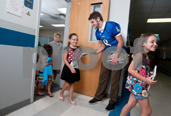 photo by Sarah A. Miller/Tyler Morning Telegraph  Grace Community School's running back Kade Clayton and children Lily Stark, 3, Brett Brown, 10, Marissa Buie, 7, and Cloie Clayton, 7.