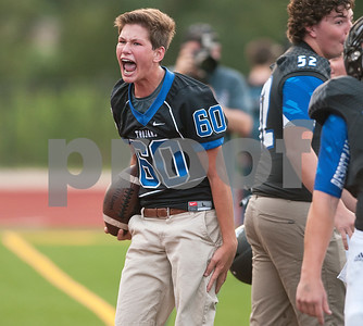 All Saints Episcopal School's ball boy eighth grader Brogan McCreery reacts after an All Saints football player made an impressive catch close to the out of bounds line Saturday night during their game against Timpson in the 10th annual Azalea Orthopedics and Texas Spine and Joint Hospital Tyler Football Classic.  (Sarah A. Miller/Tyler Morning Telegraph)