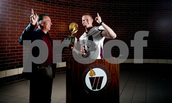 copyright 2012 Sarah A. Miller/Tyler Morning Telegraph  Whitehouse's Dylan Cantrell takes the award as one of the region's best wide receivers. Cantrell is also already committed to play at Texas Tech. Also pictured is coach Randy McFarlin.