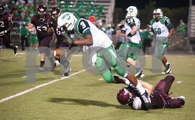 photo by Sarah A. Miller/Tyler Morning Telegraph  Arp's (31) Gabe Reynolds brings down Tatum's (3) J.D. Taylor during their game at home against Tatum Friday night.