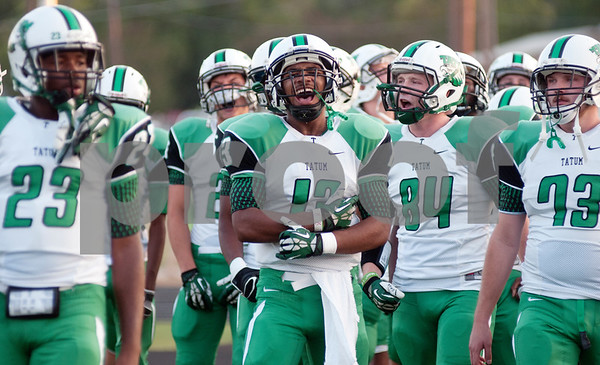 photo by Sarah A. Miller/Tyler Morning Telegraph  Tatum varsity football players get themselves pumped up before taking the field for their game Friday night against Arp in Arp.