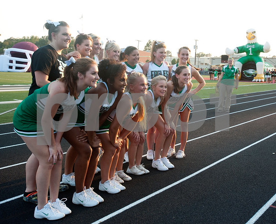 photo by Sarah A. Miller/Tyler Morning Telegraph  Tatum cheerleaders have their photo taken before the football game Friday night against Arp in Arp.