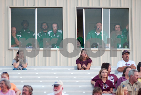 photo by Sarah A. Miller/Tyler Morning Telegraph  Tatum High School football coaches watch the action on the field from the press box Friday night during their game against Arp at Arp.