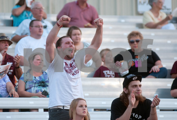 photo by Sarah A. Miller/Tyler Morning Telegraph  Arp High School football fan Austin Atchley of Arp cheers for his team Friday night as they played their home opener against Tatum.