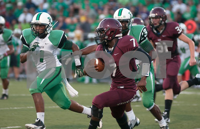 photo by Sarah A. Miller/Tyler Morning Telegraph  Arp's (7) Marcalas Johnson carries the ball during their game at home against Tatum Friday night.