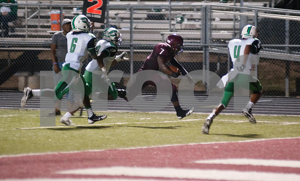photo by Sarah A. Miller/Tyler Morning Telegraph  Arp's (7) Marcalas Johnson makes a touchdown run in the final seconds of the second quarter of their game at home against Tatum Friday night.