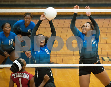 photo by Sarah A. Miller/Tyler Morning Telegraph  John Tyler's (6) Kashanti Flowers get the ball over the net Friday afternoon during their game against Texarkana Arkansas High School in the Tyler Volleyball Tournament at John Tyler High School. Also pictured is (10) DeDe Rouge.