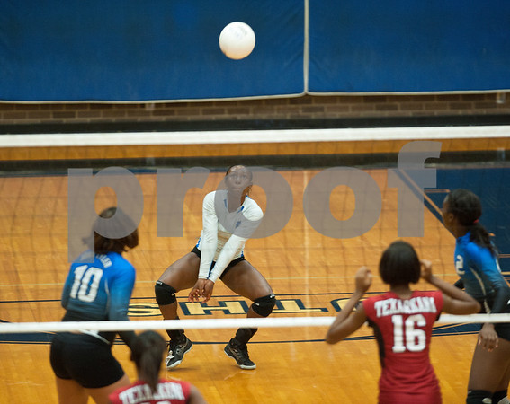 photo by Sarah A. Miller/Tyler Morning Telegraph  John Tyler's (8) Aaliyah Waalee bumps the ball during their game against Texarkana Arkansas High School Friday afternoon during the Tyler Volleyball Tournament at John Tyler High School.