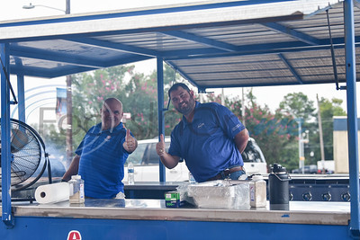 Republic Services Operation Manager Duane Weatheford (left) and Jacksonville Chamber Chairman of the Board Tom Trimble (right) give a thumbs up while grilling burgers at the Tomato Bowl Tailgate event on Friday, August 30. Republic Services sponsored the event at the Norman Activity Center. (Jessica T. Payne/Tyler Morning Telegraph)
