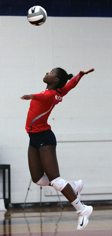 . Oberlin\'s Nya Grady- Norman serves against Firelands. Randy Meyers -- The Morning Journal
