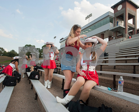 Robert E. Lee High School Southern Belle drill team member Grace Camp helps Darcy Stiefer with her hat before the REL football game against Marshall held at Christus Trinity Mother Frances Rose Stadium.  (Sarah A. Miller/Tyler Morning Telegraph)