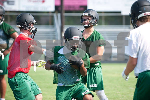 Bishop Thomas K. Gorman football player junior Ethan Milton has the ball during practice at McCallum Stadium Wednesday in Tyler.  (photo by Sarah A. Miller/Tyler Morning Telegraph)