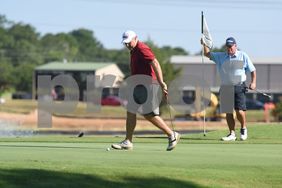 Mike Custer watches his putt during the Hollytree County Club Men's Club Championship Saturday August 6, 2016.  (Sarah A. Miller/Tyler Morning Telegraph)