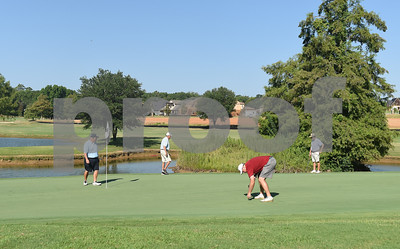 David Bridges, Reggie Howell, Mike Custer and James Mills play the 13th green during the Hollytree County Club Men's Club Championship Saturday August 6, 2016.  (Sarah A. Miller/Tyler Morning Telegraph)