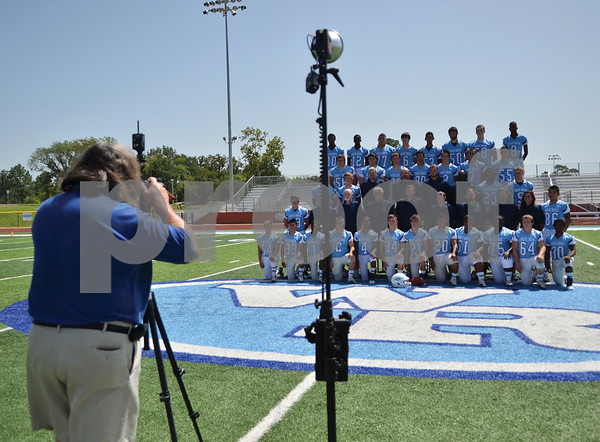 The West Rusk Raiders football team takes its team photos at Bruce Bradshaw Stadium. (Victor Texcucano)