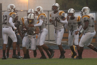 Stony Point celebrates a touchdown against Shoemaker Thursday at Leo Buckley Stadium.