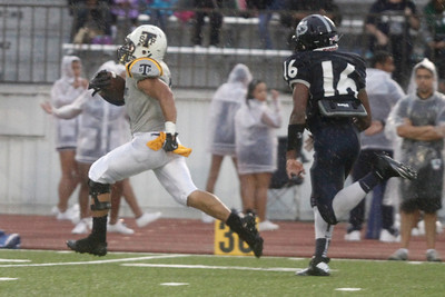 Stony Point's Joseph Marrero makes a touchdown run against Shoemaker Thursday at Leo Buckley Stadium.