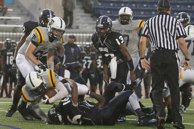 Stony Point's Xavier Mays is taken down by Shoemaker players Thursday at Leo Buckley Stadium.