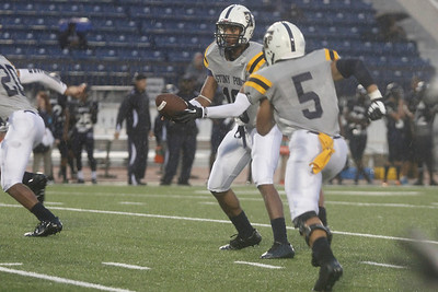 Stony Point's Damian Lindley passes the ball off to Joseph Marrero against Shoemaker Thursday at Leo Buckley Stadium.
