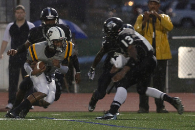 Stony Point's Justin Gamble makes a run against Shoemaker Thursday at Leo Buckley Stadium.