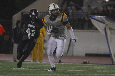 Stony Point's Wes Morre makes a run against Shoemaker Thursday at Leo Buckley Stadium.