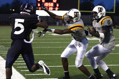 Stony Point players push Shoemaker's Johnny Jefferson out of bounds Thursday at Leo Buckley Stadium.