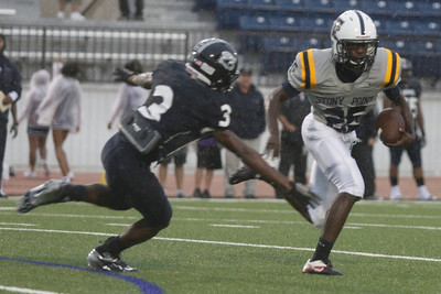Stony Point's Malik Morgan makes a run against Shoemaker Thursday at Leo Buckley Stadium.