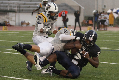 Shoemaker's Johnny Jefferson is taken down by Stony Point players Thursday at Leo Buckley Stadium.