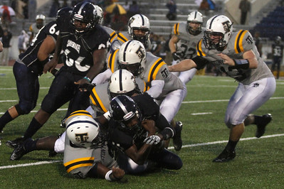 Stony Point players take down Shoemaker's Ziere Banner Thursday at Leo Buckley Stadium.