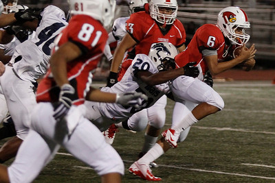 Del Valles Juan Padron  is taken down by McNeil's DeAndre Conner Friday at Veterans Stadium.