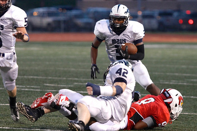 McNeil's Donnie Holmes makes a run with the ball against Del Valle Friday at Veterans Stadium.