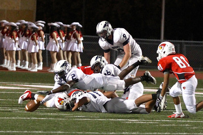 Del Valle and McNeil players scramble to get control of a loose ball Friday at Veterans Stadium.