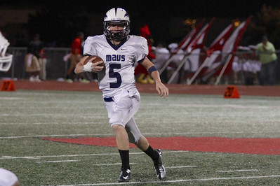 McNeil's Colton Russell makes a run against Del Valle Friday at Veterans Stadium.