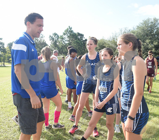 Grace Community School's coach Jason Montier talks to the girls teams before the Tyler Lee Cross Country Classic Saturday morning held at the University of Texas at Tyler.  (Sarah A. Miller/Tyler Morning Telegraph)
