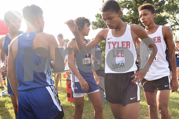 Robert E. Lee twins Tye Valdez and Trestan Valdez congratulate runners after the open division varsity boys race at the Tyler Lee Cross Country Classic Saturday morning held at the University of Texas at Tyler.  (Sarah A. Miller/Tyler Morning Telegraph)