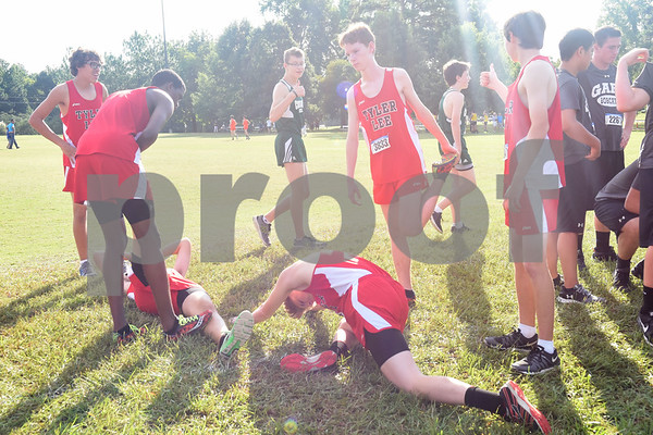 Junior variety members of the Robert E. Lee cross country team stretch before the Tyler Lee Cross Country Classic Saturday morning held at the University of Texas at Tyler.  (Sarah A. Miller/Tyler Morning Telegraph)