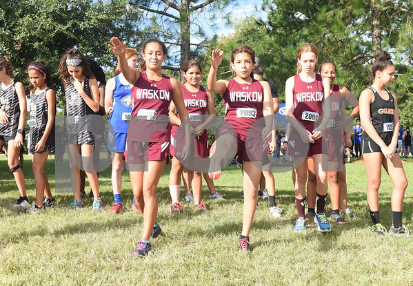 The Waskom High School girls cross country teams warms up for the Tyler Lee Cross Country Classic Saturday morning held at the University of Texas at Tyler.  (Sarah A. Miller/Tyler Morning Telegraph)