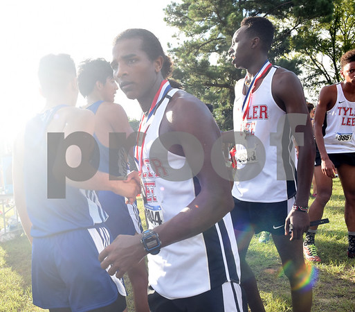 Robert E. Lee's Haftu Knight wears his medal after winning the open division varsity boys race at the Tyler Lee Cross Country Classic Saturday morning held at the University of Texas at Tyler.  (Sarah A. Miller/Tyler Morning Telegraph)