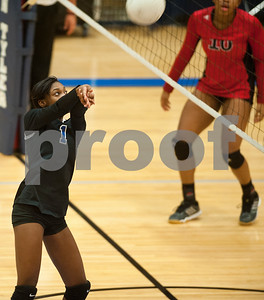 John Tyler's Andreanna Ellison hits the ball back over the net during their volleyball game Tuesday night home against Robert E. Lee.  (Sarah A. Miller/Tyler Morning Telegraph)