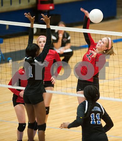 Robert E. Lee's Savannah Saczek (13) spikes the ball over the net during their volleyball game Tuesday night at John Tyler High School.   (Sarah A. Miller/Tyler Morning Telegraph)