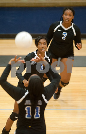 John Tyler's Kandice Jackson (11) sets the ball during their volleyball game Tuesday night at home again Robert E. Lee. (Sarah A. Miller/Tyler Morning Telegraph)
