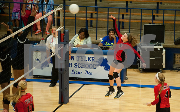 Robert E. Lee's Olivia Cid (9) spikes the ball over to the John Tyler side during their volleyball game Tuesday night at John Tyler High School.  (Sarah A. Miller/Tyler Morning Telegraph)