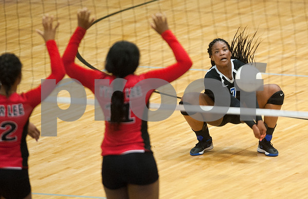 John Tyler's Chenique Baxter digs the ball during their volleyball game Tuesday night at home against Robert E. Lee. (Sarah A. Miller/Tyler Morning Telegraph)