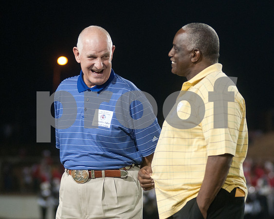 photo by Sarah A. Miller/Tyler Morning Telegraph  John Tyler 1973 football team member John McKinley talks with Allen Wilson, head coach of the 1994 John Tyler football team, during a celebration of the TISD 2013 Athletic Hall of Fame inaugural class Friday night at Trinity Mother Frances Rose Stadium. Wilson lead the John Tyler football team to a state championship and returned to the finals in 2000.
