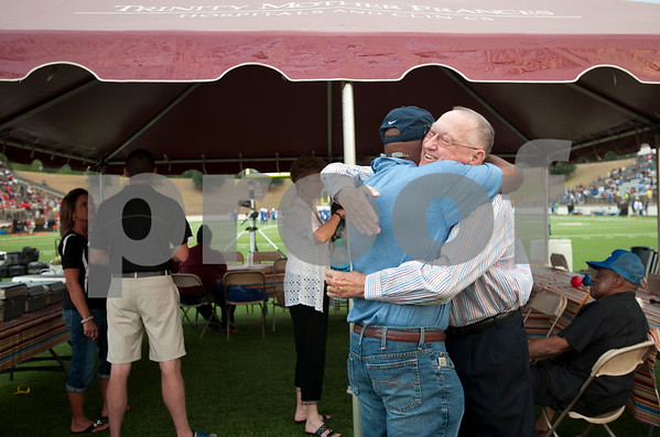 photo by Sarah A. Miller/Tyler Morning Telegraph  John Tyler High School 1973 football team player Mike Taylor, left, and defensive coach Darvin Hooker hug as the reunite at a celebration of the TISD 2013 Athletic Hall of Fame inaugural class Friday night at Trinity Mother Frances Rose Stadium. The 1973 John Tyler football team was one of 12 inductees.