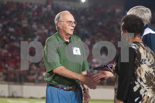 photo by Sarah A. Miller/Tyler Morning Telegraph  Billy Hall, former Athletic Director at Tyler ISD is honored during a celebration of the TISD 2013 Athletic Hall of Fame inaugural class Friday night at Trinity Mother Frances Rose Stadium.
