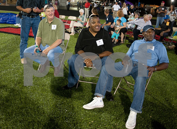 "photo by Sarah A. Miller/Tyler Morning Telegraph  John Tyler High School 1973 football team players Herb Bristow, Cary ""Tuffy"" Wilson and Mike Taylor watch the John Tyler-Rober E. Lee football game Friday as part of a celebration of the TISD 2013 Athletic Hall of Fame inaugural class Friday night at Trinity Mother Frances Rose Stadium. The 1973 John Tyler football team inducted for capturing the 1973 state football championship lead by Earl Campbell."