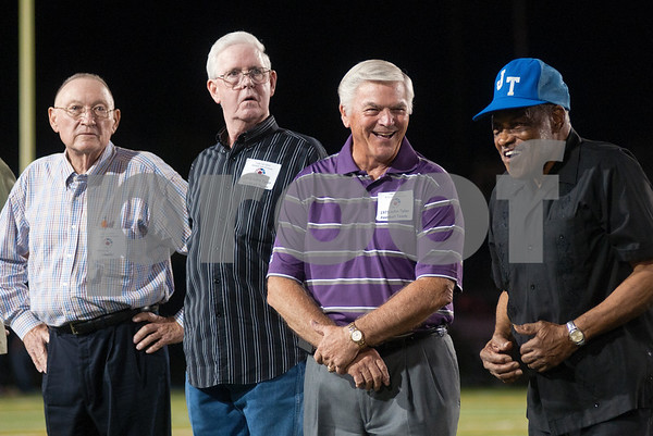 photo by Sarah A. Miller/Tyler Morning Telegraph  Members of the John Tyler High School 1973 football team attend a celebration of the TISD 2013 Athletic Hall of Fame inaugural class Friday night at Trinity Mother Frances Rose Stadium. The 1973 John Tyler football team was one of 12 inductees. From left: coach Darvin Hooker, Bill Parks, Leon VanAlstine and coach Charles Craddock.