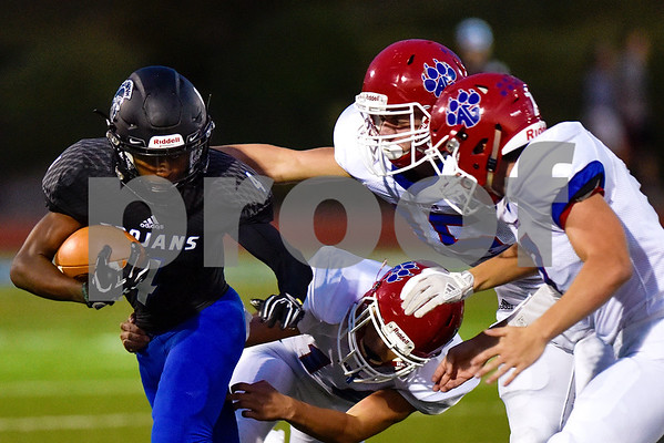 All Saints running back MJ Smith-Dukes (4) is tackled by Alba Golden players during a high school football game at All Saints Episcopal School in Tyler, Texas, on Friday, September 15, 2017. (Chelsea Purgahn/Tyler Morning Telegraph)
